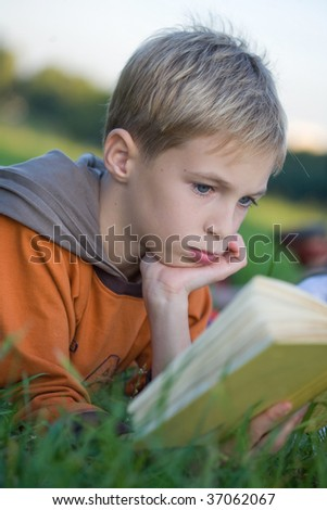 boy is reading book