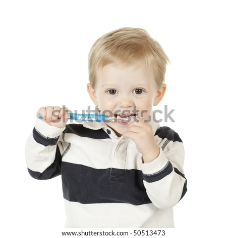 Boy is Smiling while Brushing His Teeth - stock photo