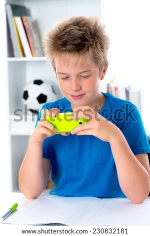 boy is using his smartphone - stock photo