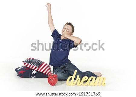 Boy is waking up in the morning stretching - stock photo