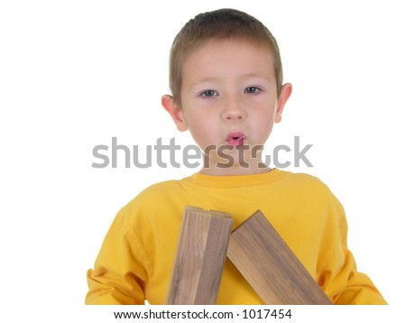 Boy joining two pieces of walnut