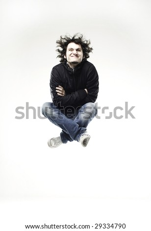 boy jumping in front of a white background - stock photo