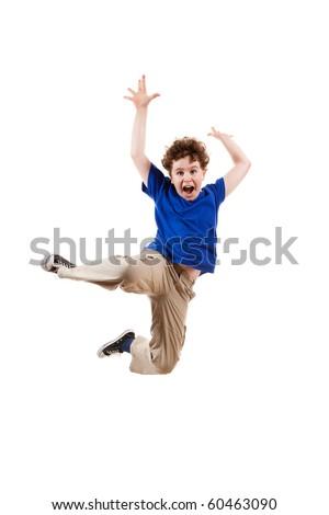 Boy jumping isolated on white background - stock photo