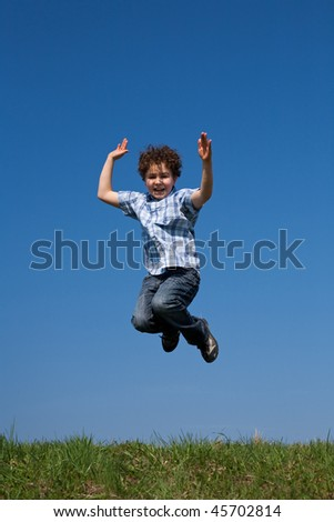 Boy jumping outdoor against blue sky