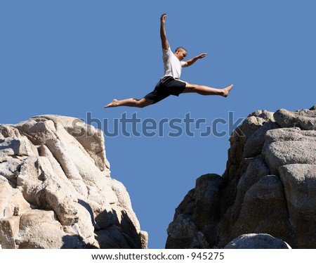Boy jumping over the mountains - stock photo