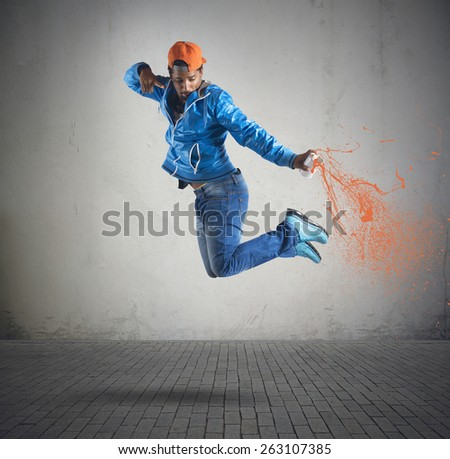 Boy jumps and color with the spray