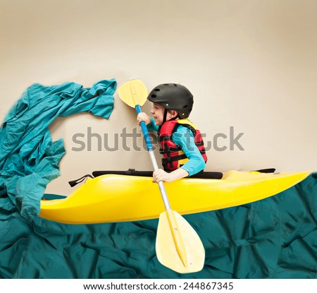 Boy kayaking through a wave. Imaginative concept