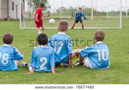 boy kicking a penalty at goal - stock photo