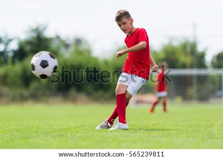 boy kicking soccer ball on sports stock photo edit now 565239811