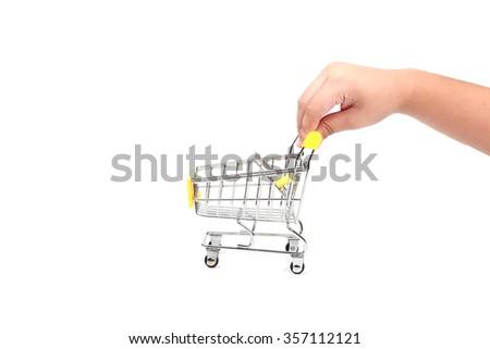 Boy kid hand push shopping trolley - stock photo