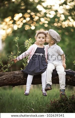 boy kissing a girl - stock photo