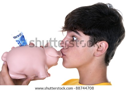 boy kissing a piggy bank on white background - stock photo