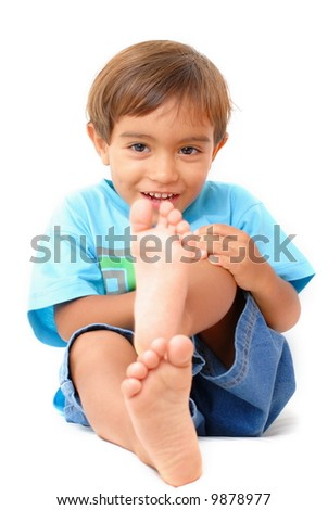 Boy laughing and holding his leg . - stock photo