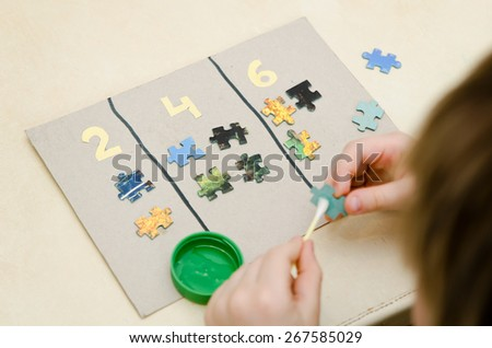 boy learning math. even number. - stock photo