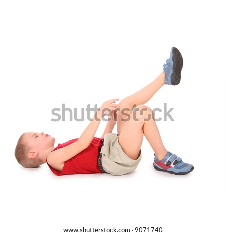boy lie isolated on white. pain leg - stock photo