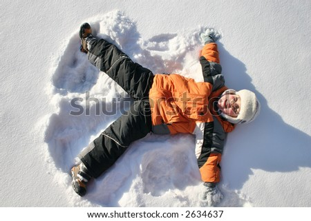 boy lies on north pole snow - stock photo