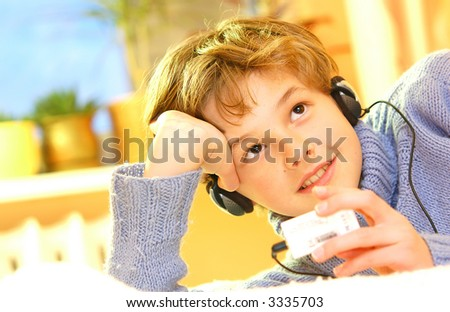 Boy listen to music in warm sunny bedroom