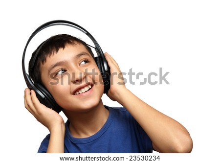 boy listening music in headphones isolated on white - stock photo