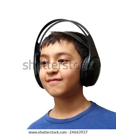boy listening music in wireless headphones - stock photo