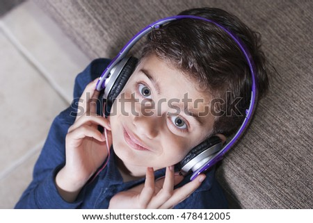 Boy listening to music. Toned image with shallow depth of field