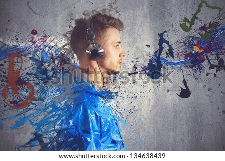 Boy listening to music with sketch effect - stock photo
