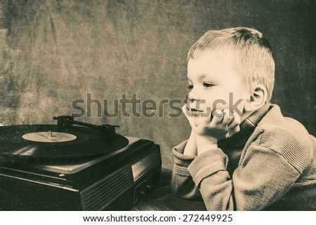 boy listening to retro music player - stock photo