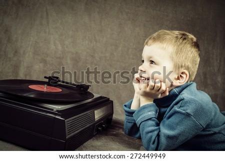 boy listening to retro music player - stock photo