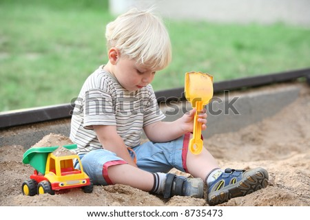 boy little children child play playground color toy sand life outdoor spring - stock photo