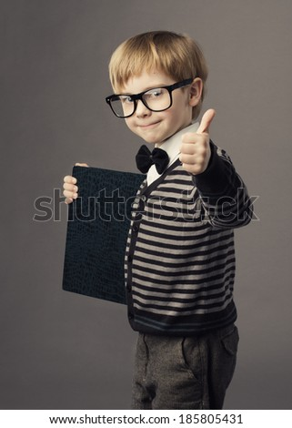 boy little smart child in glasses showing blank book, card certificate, school education advertisement  - stock photo