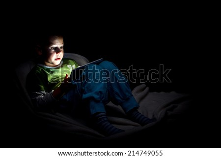 Boy looking at digital tablet  - stock photo