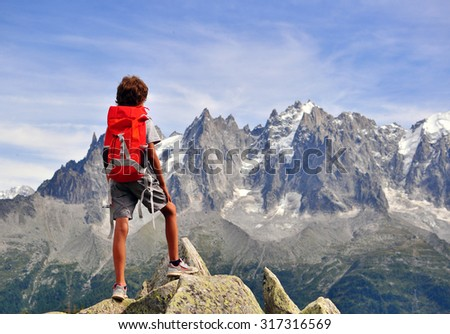 Boy looking at mountains, Chamonix Mont Blanc, France