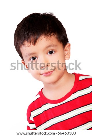 Boy looking at the camera with a small smile over white background - stock photo
