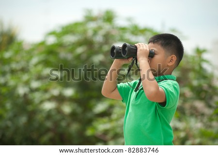 Boy looking through binocular.