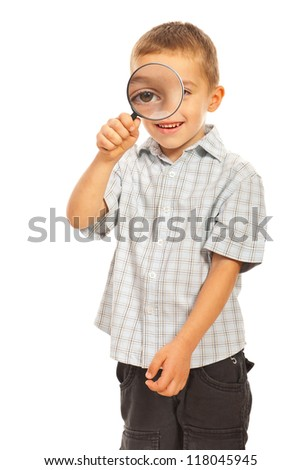 Boy looking through magnifier isolated on white background - stock photo