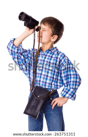 boy looking to spyglass, isolated on white - stock photo