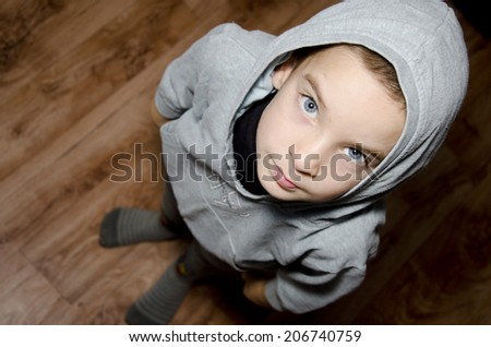 Boy looking up - stock photo
