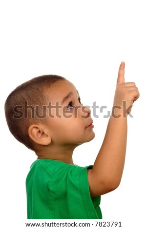 Boy looking up and pointing up - stock photo