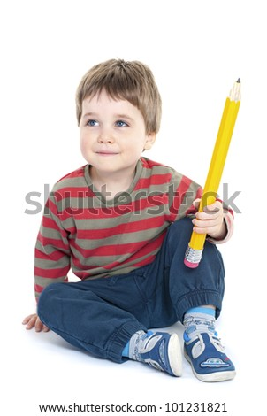 Boy looking up thinking holding giant pencil