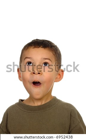 Boy looking up with a shocked or surprised expression - stock photo