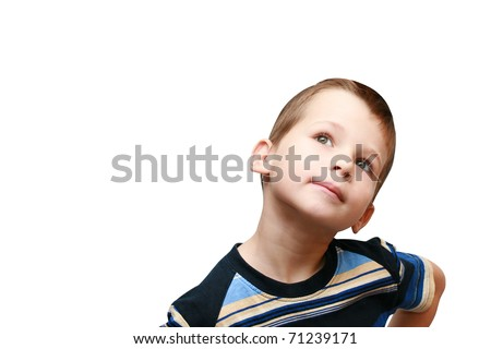boy looks up with interest - stock photo