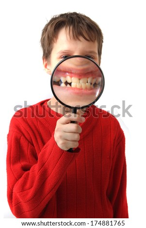 boy magnify teeth - stock photo
