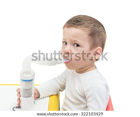 Boy makes inhalation with ultrasonic nebuliser isolated on the white background - stock photo