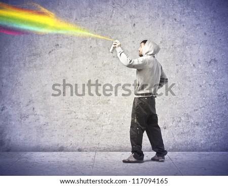 Boy making a graffiti - stock photo