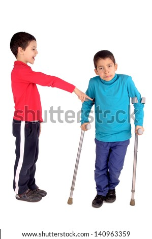 boy making fun of friend in crutches - stock photo
