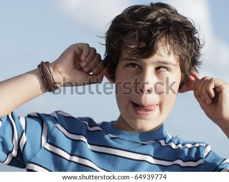 Boy making funny face - stock photo