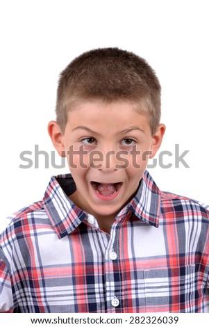 boy making funny face isolated white background - stock photo