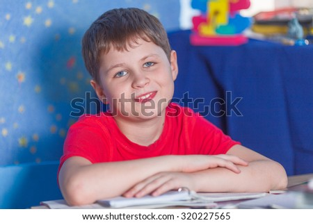 Boy making homework