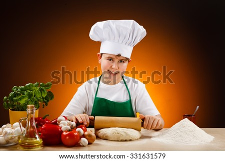 Boy making pizza dough