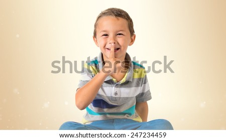 Boy making silence gesture - stock photo