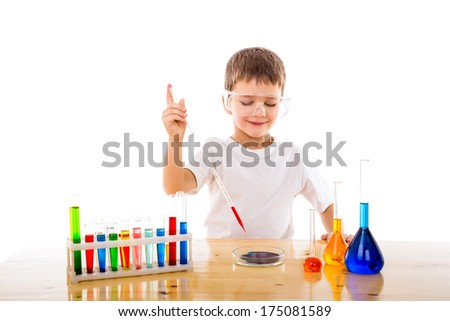 Boy mixes chemicals in the lab , isolated on white - stock photo